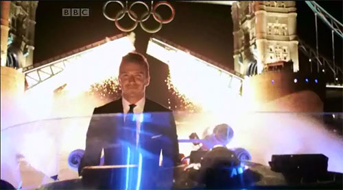 David Beckham pilots a speedboat down the Thames with the Olympic Torch