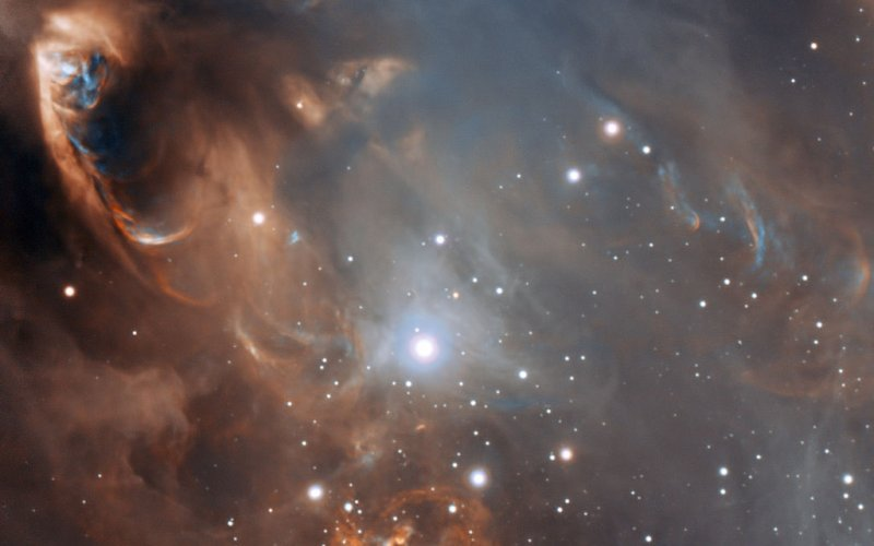 This very detailed enhanced-colour image from ESO's Very Large Telescope shows the dramatic effects of very young stars on the dust and gas from which they were born in the star-forming region NGC 6729.  Credit: ESO/Sergey Stepanenko