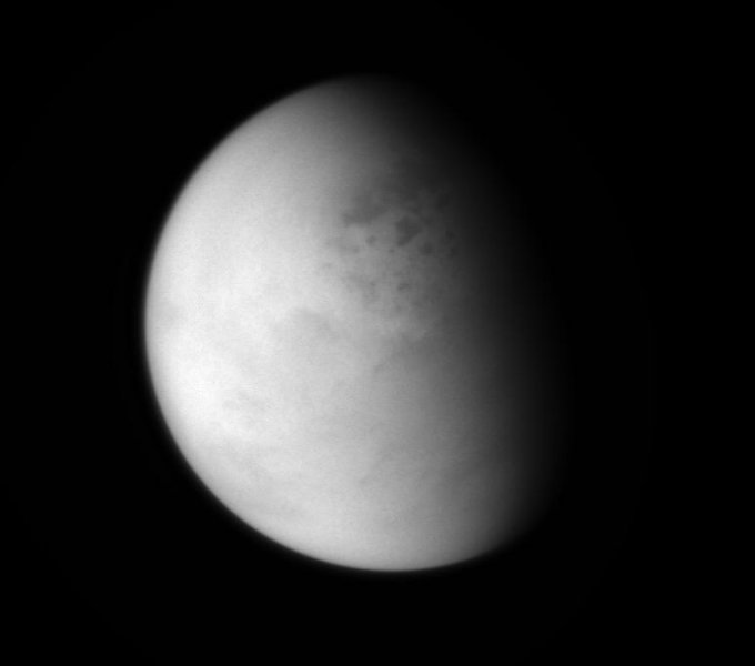 The Cassini spacecraft peers down though layers of haze to glimpse the lakes of Titan's northern regions.  The view was obtained at a distance of approximately 114,000 miles (183,000 kilometers) from Titan.   Image Credit:     NASA/JPL-Caltech/Space Science Institute