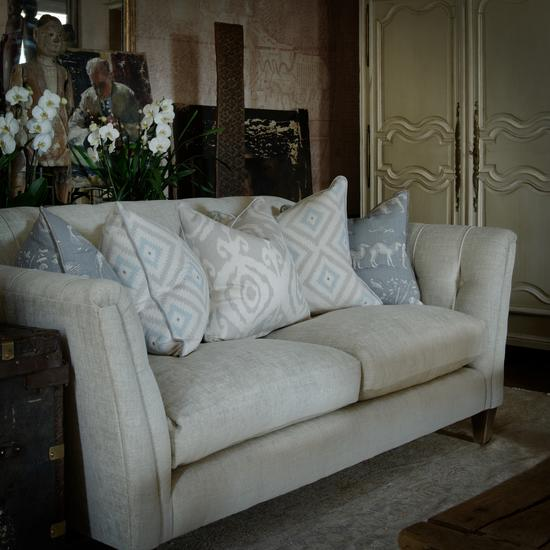 Basil Sofa in Palazzo Stone with scatters in Volcano Canvas, Glacier Powder and Kingdom Storm