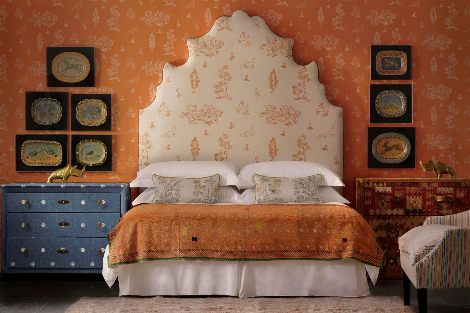 Lucifer Headboard upholstered in Friendly Folk Melon Orange Fabric against Wychwood Melon Orange Wallpaper with chest of drawers in Over the Moon Denim Fabric