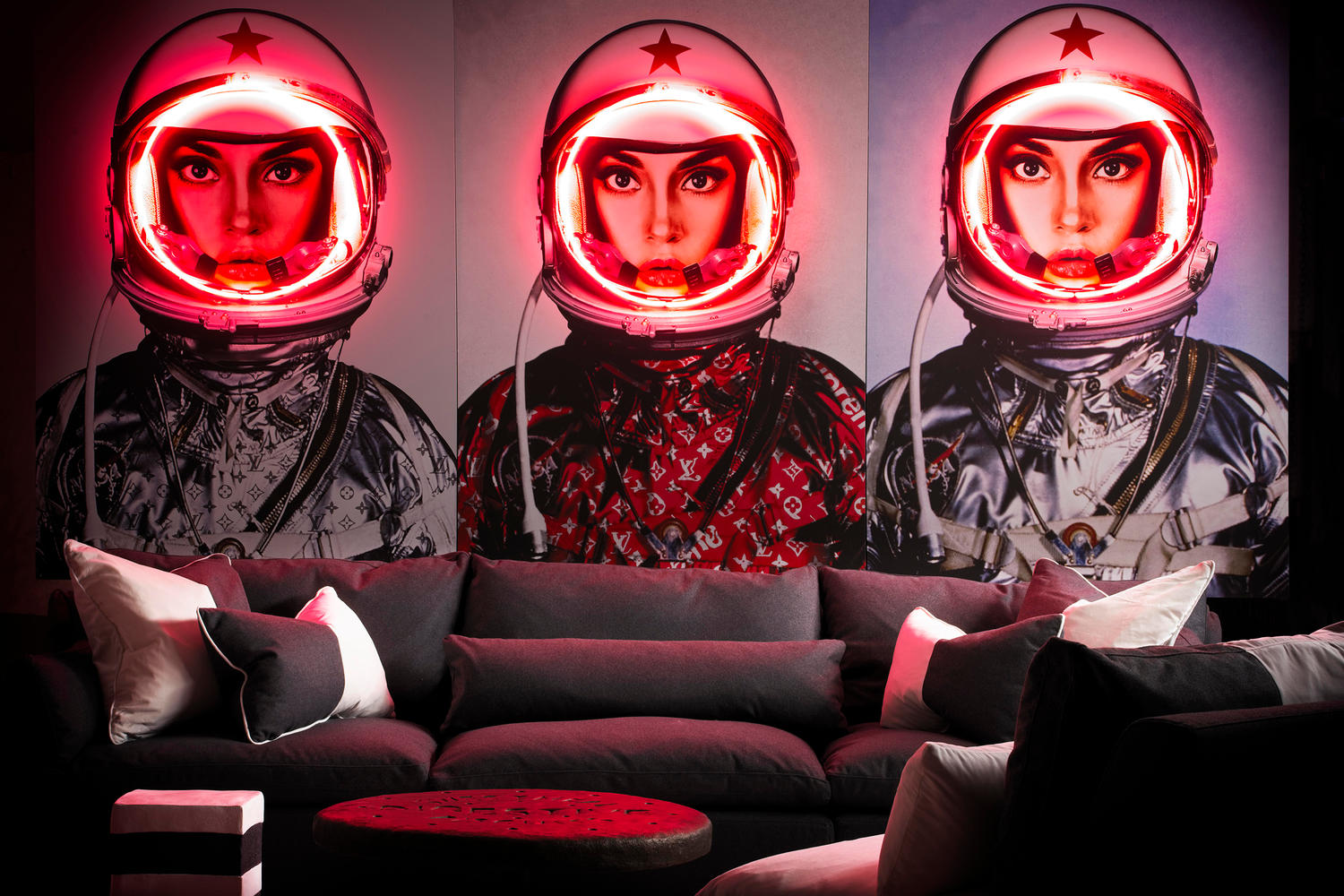 Volcano Charcoal sectional sofa with Space Girl neon artworks