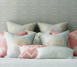 Chloe_Headboard_in_Kongo_Powder_with_Bolo_Powder_Bolo_Pink_Togo_Powder_Jumbo_Scatter_Cushions_and_Togo_Pink_and_Kongo_Powder_Bolster_Cushions