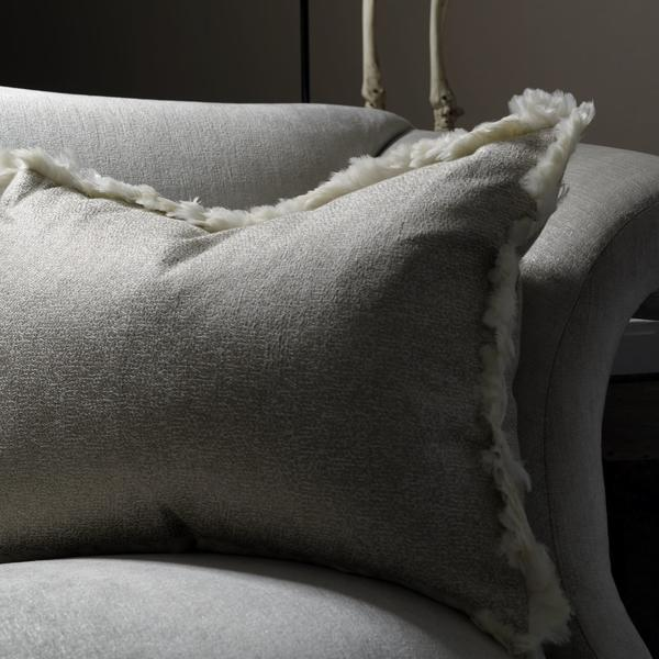 Donald_Sofa_in_Stardust_silver_with_scatter_cushion_in_Sigma_Natural_trimmed_in_Feather_White_trim