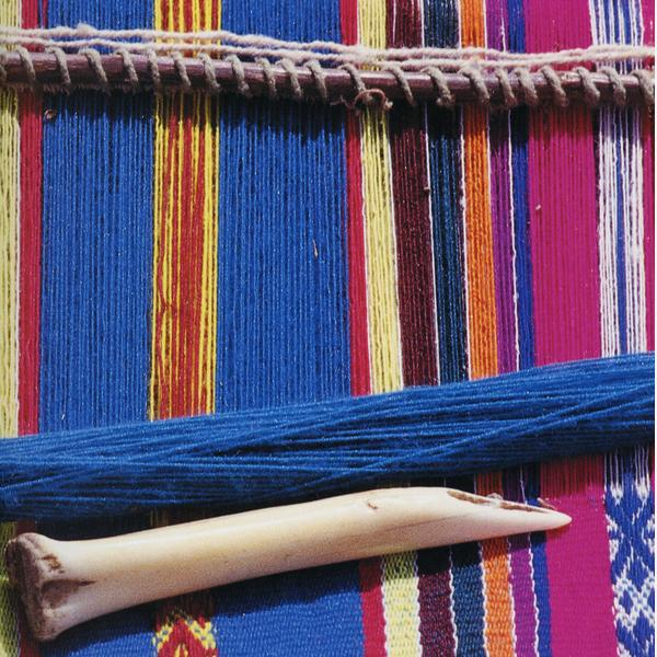 textile_loom_threads_of_colour