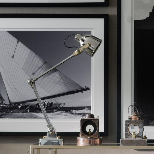 Renee_Chairs_Benson_Desk_Lights_on_the_Perplex_Console_Table__Artwork_include_Seafarer_Triptych_Sail_Away_Seafarer_Brother_Bear_1_The_Long_Road_South_Ali_Training_The_Diver_High_Flyer_After_the_Rain