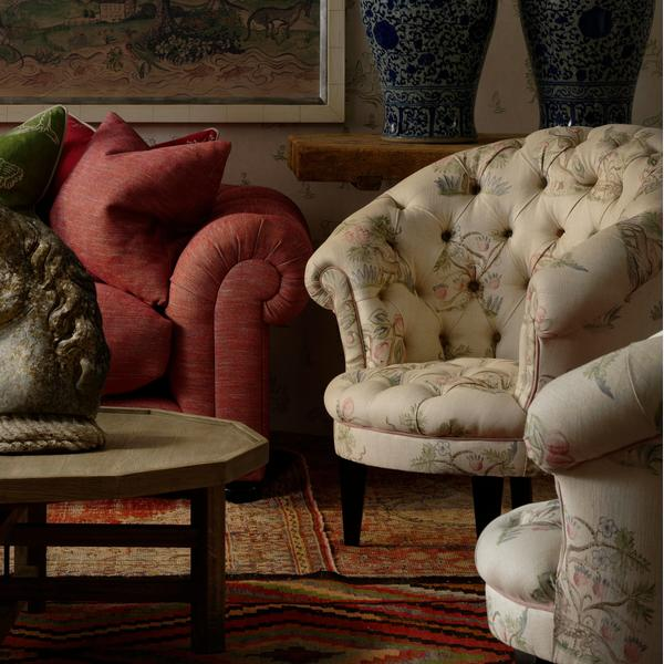Homer_Chairs_in_Hedgerow_Cerise_with_Wychwood_Basil_Green_Wallpaper_and_scatter_cushions_in_Friendly_Folk_Basil_Green_and_Huntsman_Red