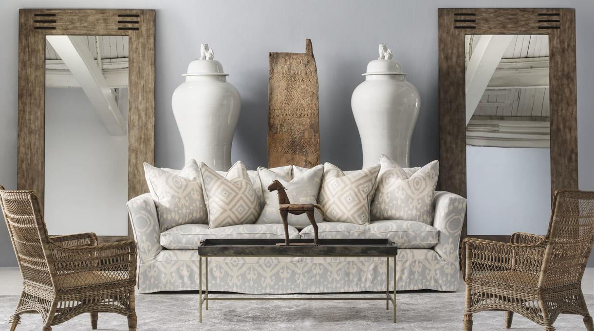 cadogan_large_sofa_in_volcano_powder_with_cushions_in_volcano_powder_glacier_powder_and_kingdom_powder_tobias_mirrors_edith_coffee_table_and_hiba_rug_lifestyle