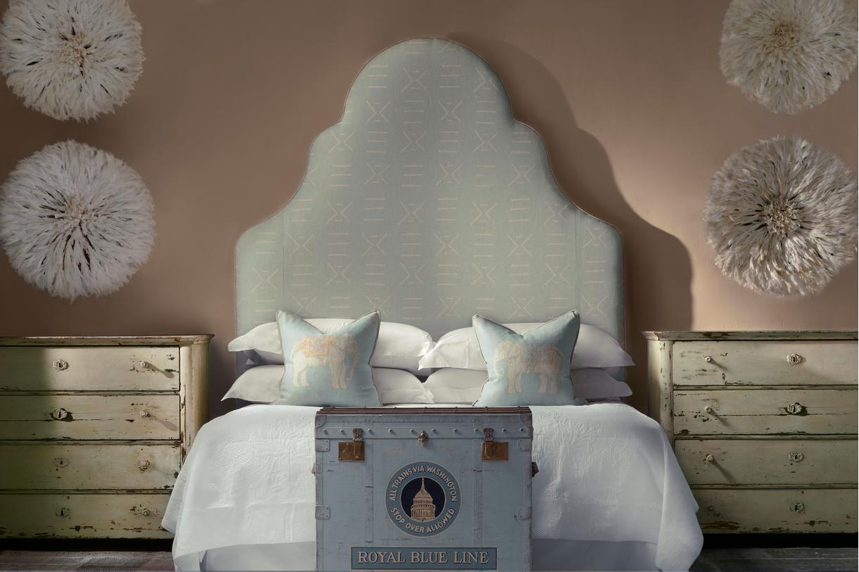 Chloe Headboard in Kongo Powder Fabric and Jumbo Powder Cushions on the bed