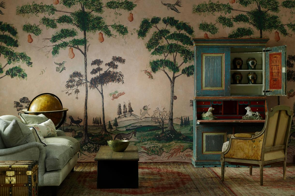 Wychwood_Happy_Blue_Wallpaper_with_Laurent_Sofa_and_scatter_cushion_in_Friendly_Folk_Happy_Blue_Fabric_. Mythical_Land_Large_Panel_Wallpaper
