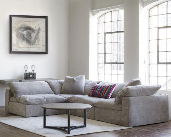 truman_sectional_sofa_grey_velvet_arthur_coffee_table_shada_rug_lifestyle_shot