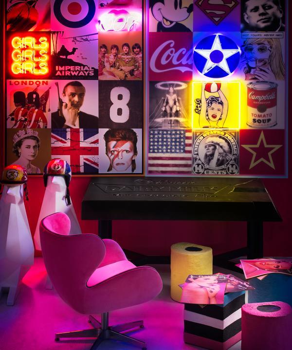 Cocoa Power desk, Kapow swivel chair in Fuchsia Fizz with America and Britain neon artworks.
