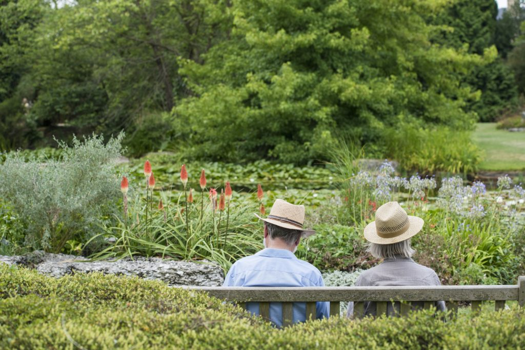 Couple enjoying the view of the lake, from the Rock garden.