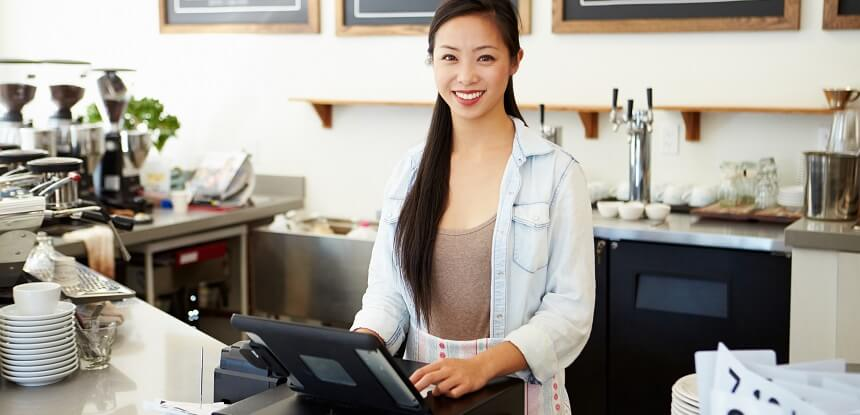 Coffee shop cashier smiling