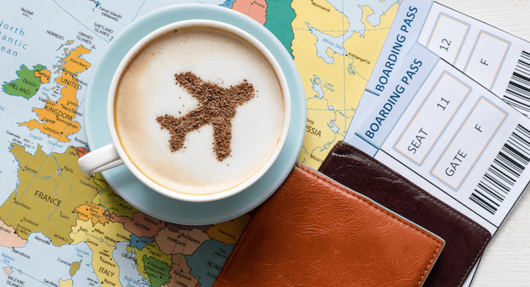 Map, passports, flight tickets and a coffee