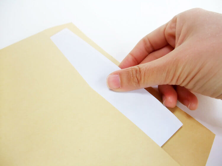 Pulling a piece of paper out of an envelope
