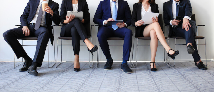 Candidates waiting for an interview at a recruitment agency