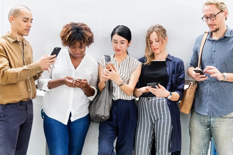 Group of people using their smartphones