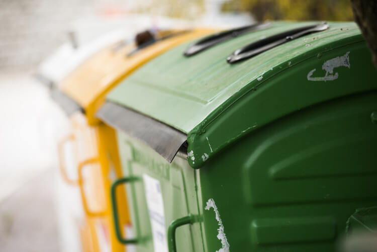 assortment of commercial waste bins
