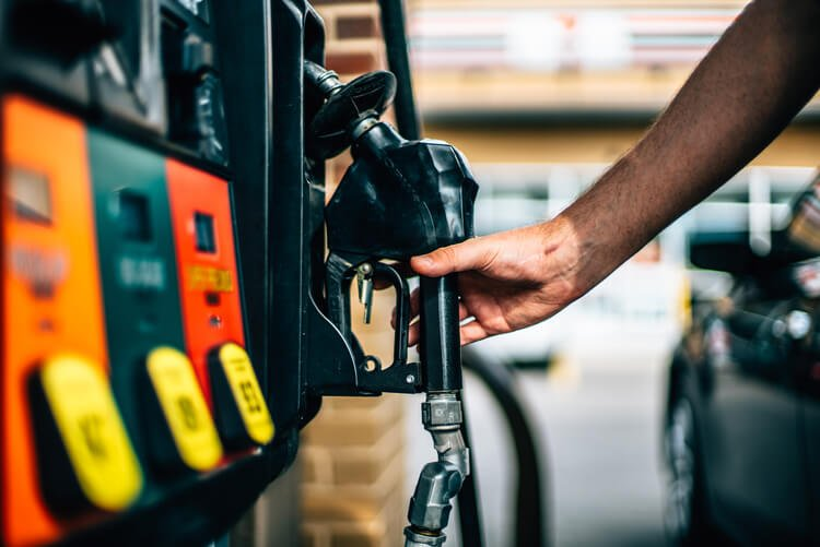 Man picking up black petrol pump
