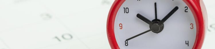 Clock sitting on a calendar