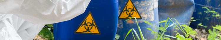 Hazardous waste barrels being removed