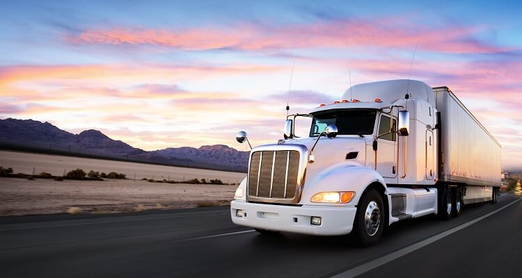 A truck driving at sunset