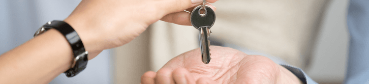 A key being passed from hand to hand