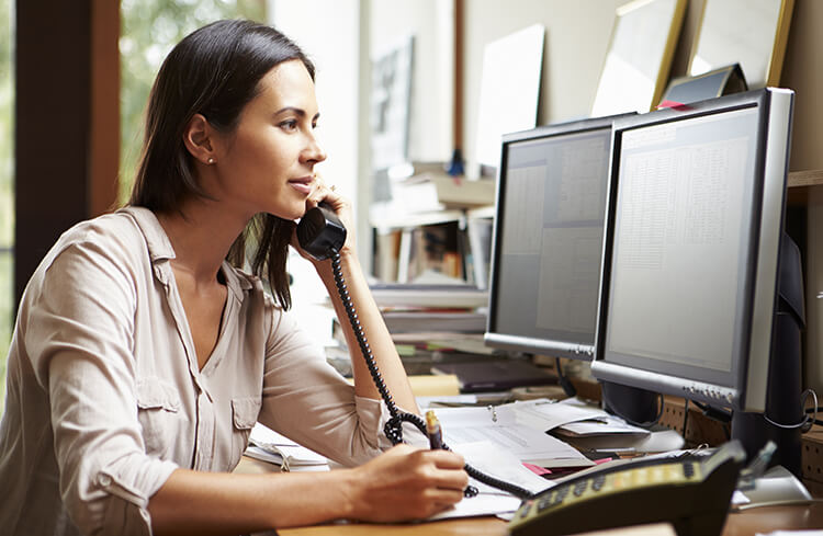 Woman speaking on the phone in a home office