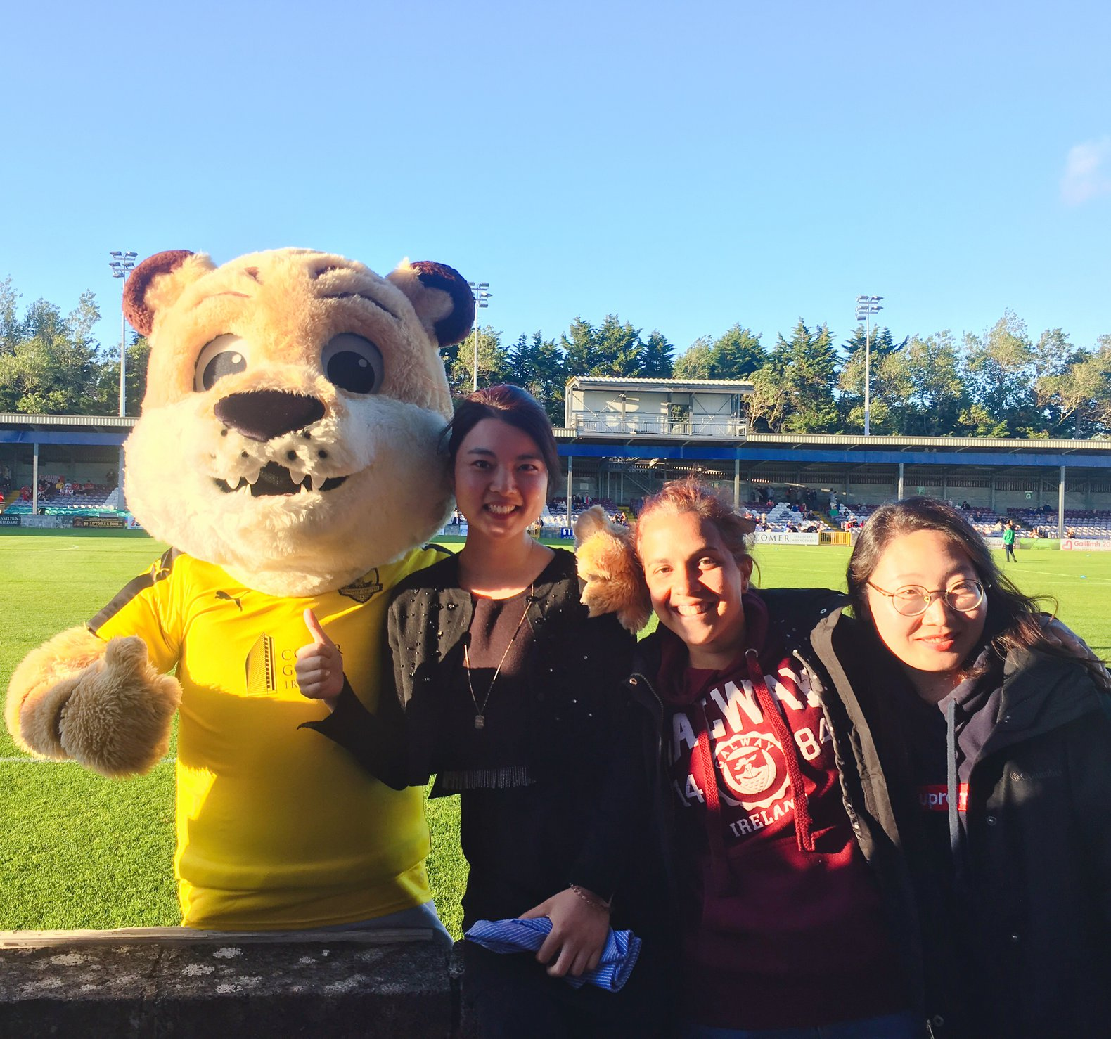 Alessandra and friends from GCI with the team mascot at a Galway United game