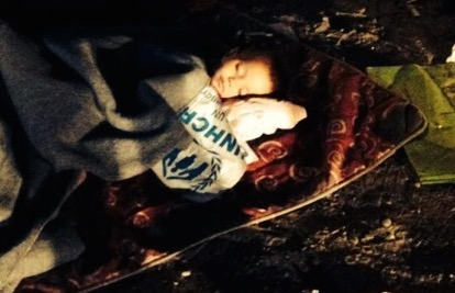 A little Boy, who is sleeping without a tent in Serbia.