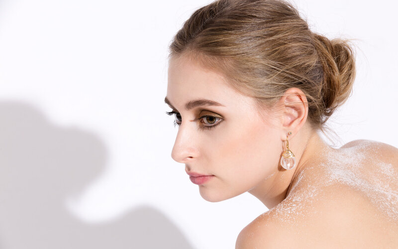 Model Amy Boyen wearing rock crystal drop earrings in 18ct gold, from the award-nominated Careless Rhythm collection
