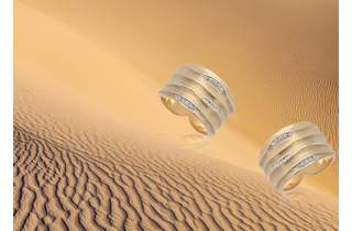 Two solid gold biiju cocktail rings with a wavy design inspired by sand dunes tumbling down the slope of an African sand dune