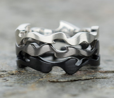 Stack of 3 organically shaped rings in diff finishes - brushed silver, the soft grey of black rhodium & dark black ceramic