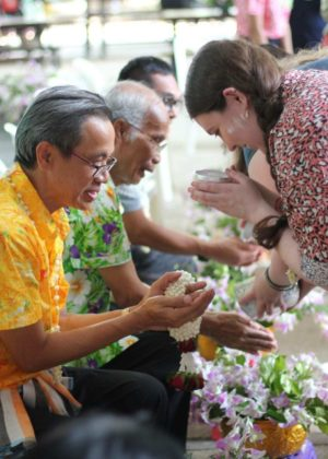Allie TESOL showing respect to the university President at the Songkran celebrations