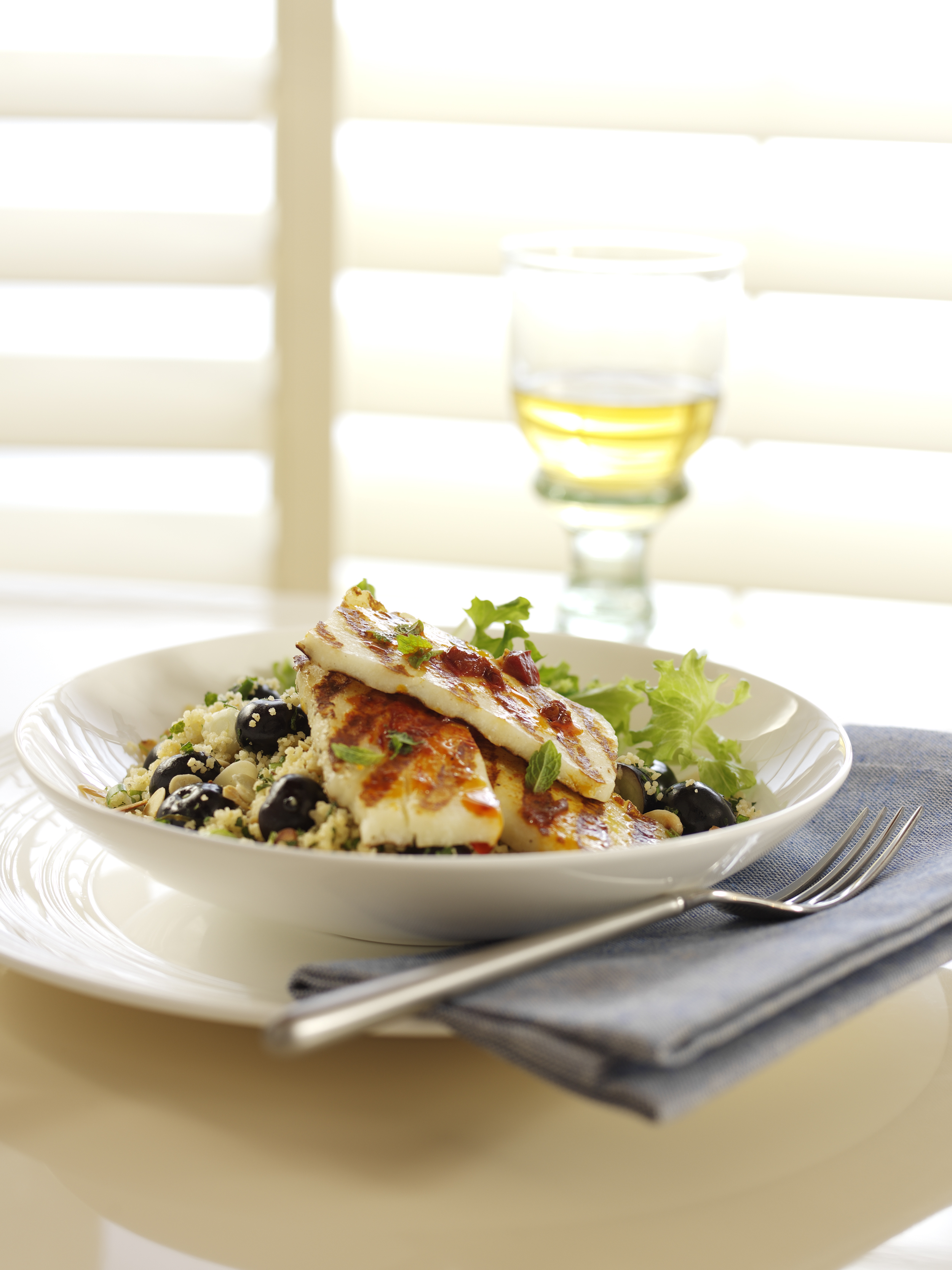 Griddled Harissa Marinated Halloumi with Berry World Blueberry Spring Onion and Toasted Almond Couscous 75istnxwa