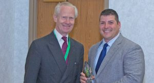 Anthony Bruggeman receives Chairman's award from Damon de Laszlo