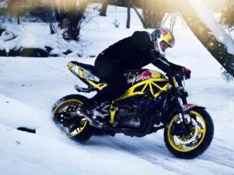 snow drifting motorbike stunt rider arunas gibieza