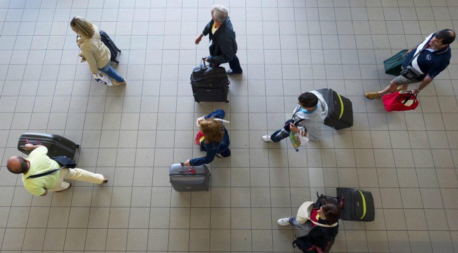 Reizigers corona angst schiphol nieuws virus doets reizen