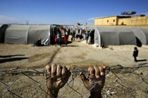 Refugiats sirians a la frontera turca / Yannis Behrakis per a Reuters
