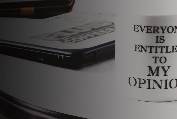 """""""Everyone is entitled to my opinion"""" coffee mug on table"""