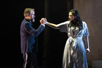 Macbeth and Lady Macbeth gripping hands