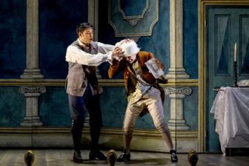 Figaro wrestles with Cherubino