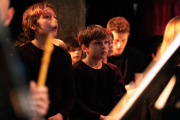 Children performing in the St John Passion with ETO