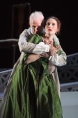 Scarpia grabbing Tosca