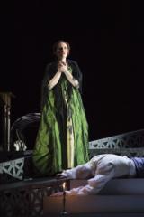 Tosca standing over Scarpia