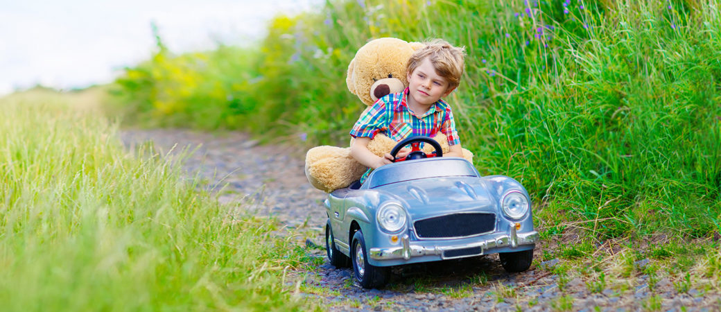 Investment propositions boy in car
