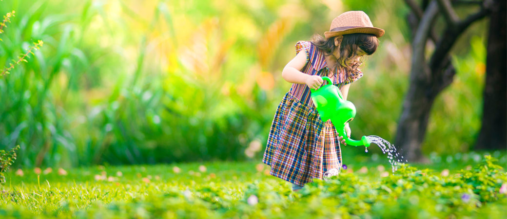 Investments girl watering plants