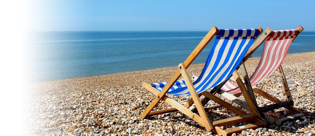 Tourism leisure deckchairs on beach
