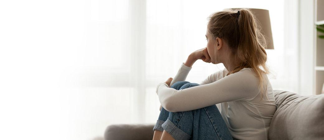 Vulnerable clients lady gazing through window